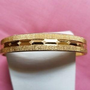 Vintage Monet gold tone bangle bracelet etched